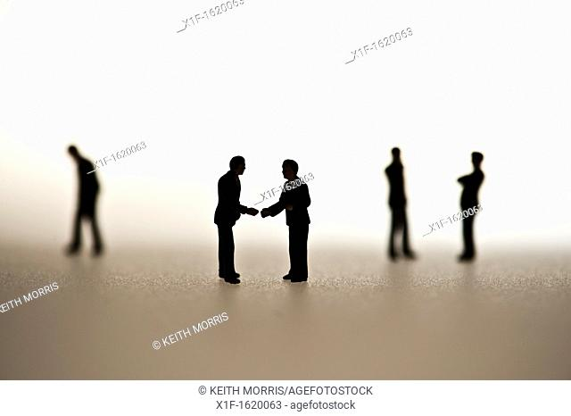 silhouetted small figures conceptual image for business men meeting