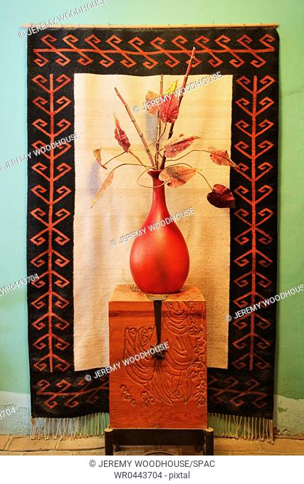 Decorative Vase on a Wooden Chest