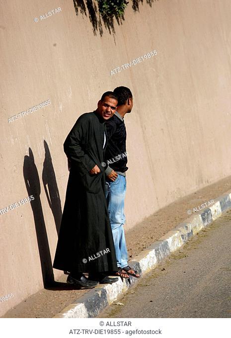 YOUNG MUSLIM MEN & SHADOWS; EDFU, EGYPT; 09/01/2013