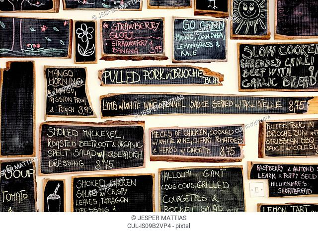 Quirky coffee shop interior with menu on chalked blackboards