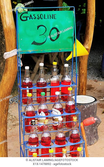 Thailand, Trat province, Island of Koh Chang, Village of Bangbao, Bottles of Gasoline for sale