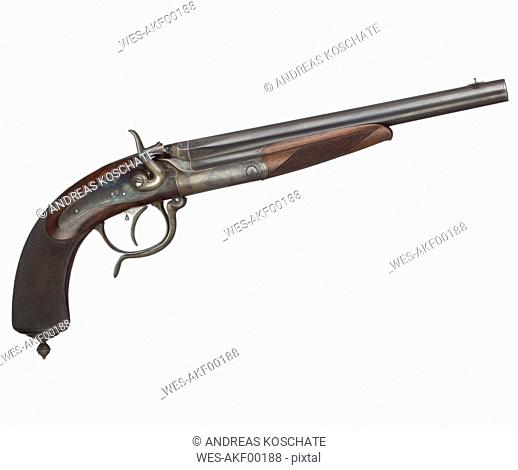 Close up of antique duel pistol against white background