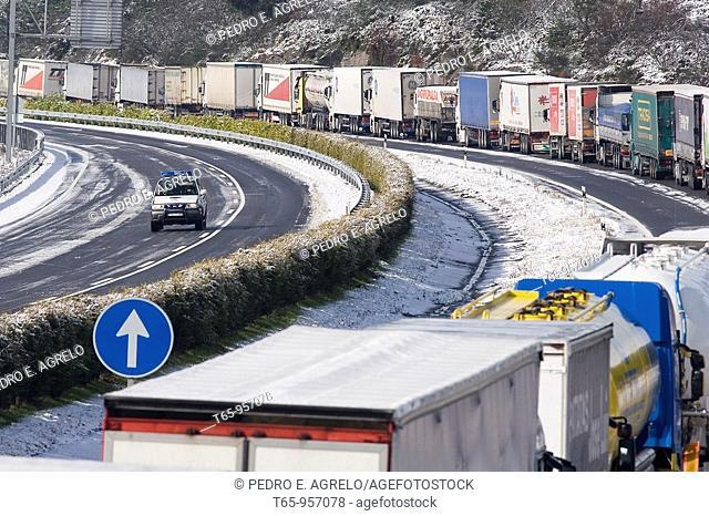 Queue of trucks at the A6 Freeway near Guitiriz. Galicia, Spain