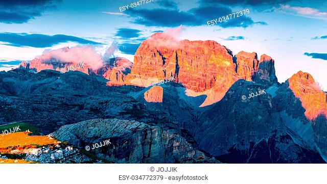 Colorful summer scene in the National Park Tre Cime De Lavaredo. Bloody sunset in Dolomites Alps, South Tyrol. Location Auronzo, Italy, Europe