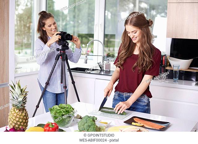 Women recording video for their food blog