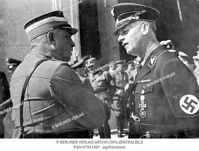 Nuremberg Rally 1937 in Nuremberg, Germany - German ambassador to the United Kingdom Joachim von Ribbentrop (R) talks to Reich Minister Hans Kerrl in front of...