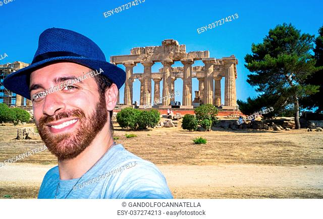 tourist take a selfie in the temple of Selinunte, Sicily