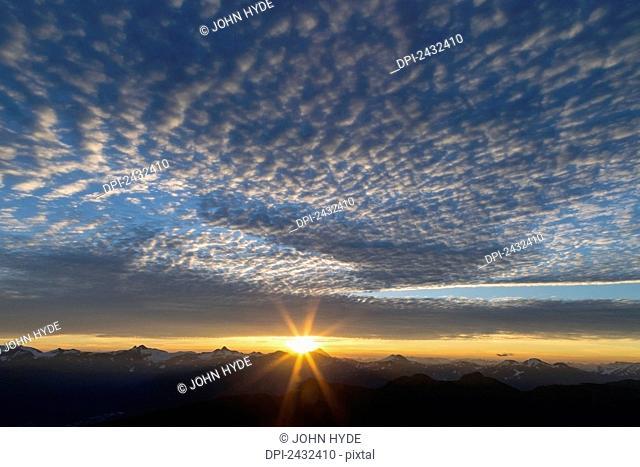 Sunrise over the Coast Range as seen from the alpine on Douglas Island in Alaska's Tongass National Forest, Juneau. Alaska