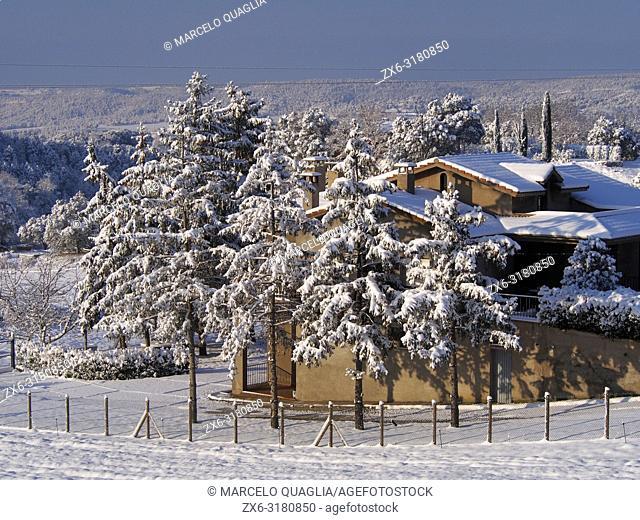 Winter morning at Santa Eulàlia village countryside after night snowstorm. Lluçanès region, Barcelona province, Catalonia, Spain