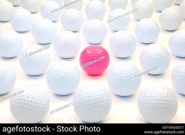 Pattern with white and pink golf balls on the table