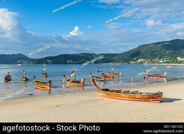 Phuket, Thailand Traditional longtail boats on the shore of Patong beach in Phuket island, Thailand, Andaman sea