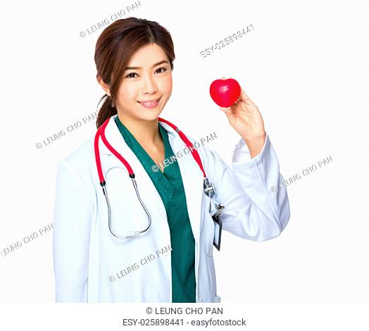Woman doctor hold with heart ball