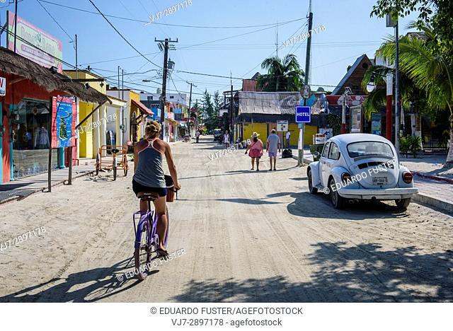 Tourists in a street of Isla Holbox, Quintana Roo (Mexico)