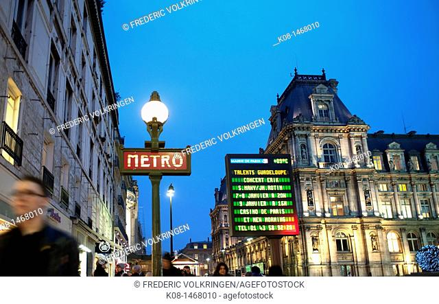 City Hall and metro sign at night, Paris, France