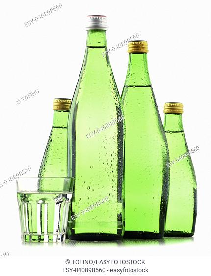 Glass bottles of mineral water isolated on white background