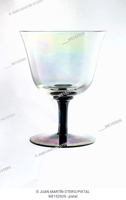 Empty glass cup on white or light gray background with black detail