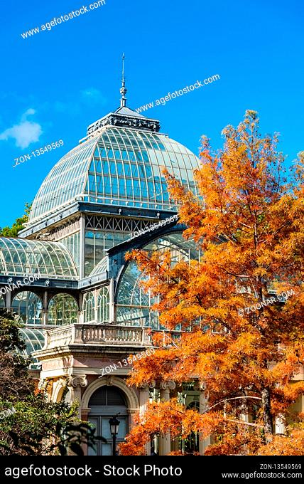 Madrid, Spain - November 2, 2018: Exterior view of Crystal Palace, Palacio de Cristal, in Retiro Park. View against blue sky at autumn