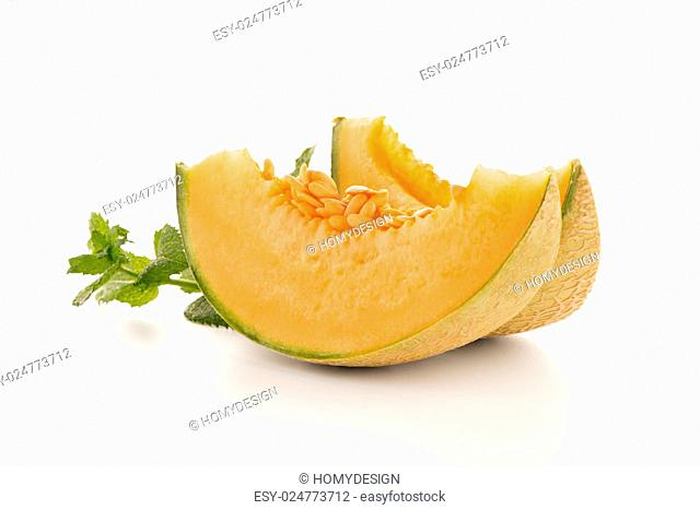 Juicy honeydew melon on a white background