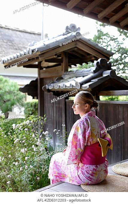 Caucasian woman wearing yukata in traditional Japanese house