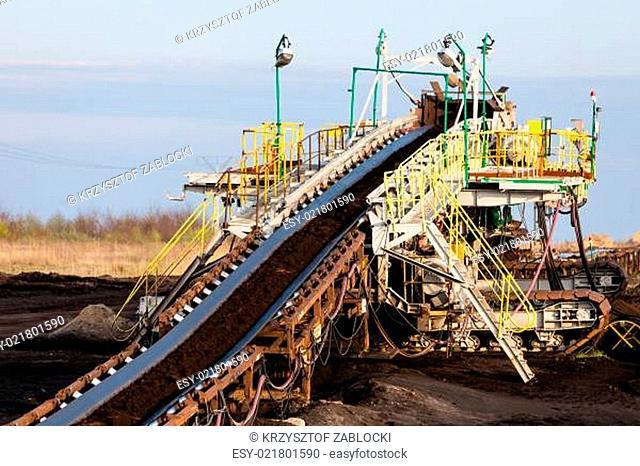 Opencast brown coal mine. Belt conveyor