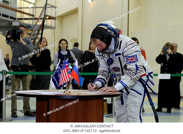 At the Gagarin Cosmonaut Training Center in Star City, Russia, Expedition 46-47 crewmember Tim Peake of the European Space Agency signs in for his qualification...