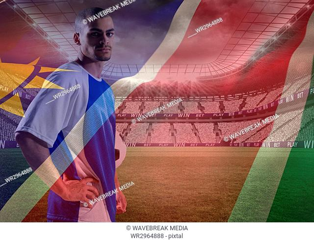 soccer player with the hands on the waist in the field, superimpose with flag
