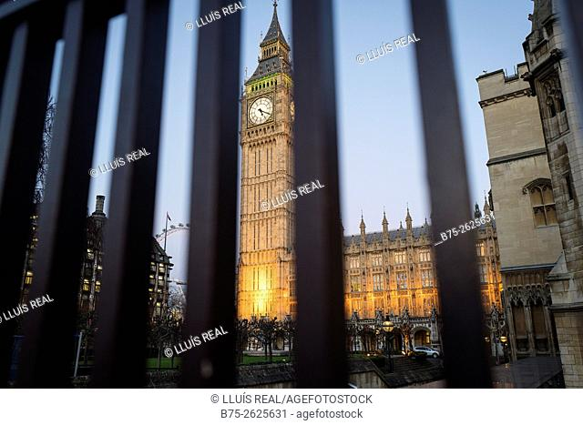 The House of Parliament with Big Ben tower viewed through grates courtyard of Parliament. City of Westminster, London, England, United Kingdom, Europe