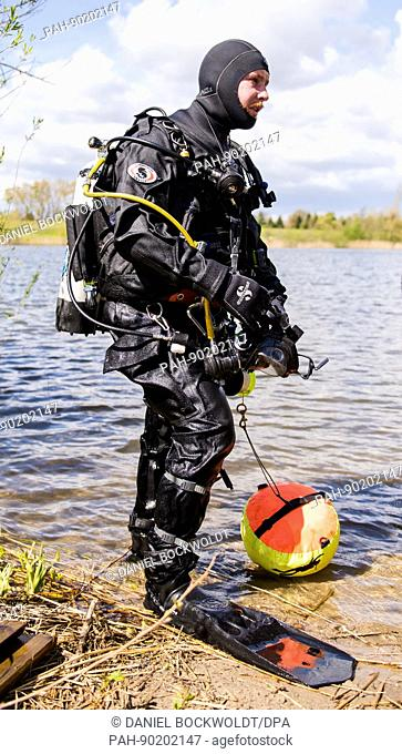 A police diver during training at the Hohendeicher Lake in Hamburg, Germany, 27 April 2017. Police divers from Hamburg and 10 other German federal states...