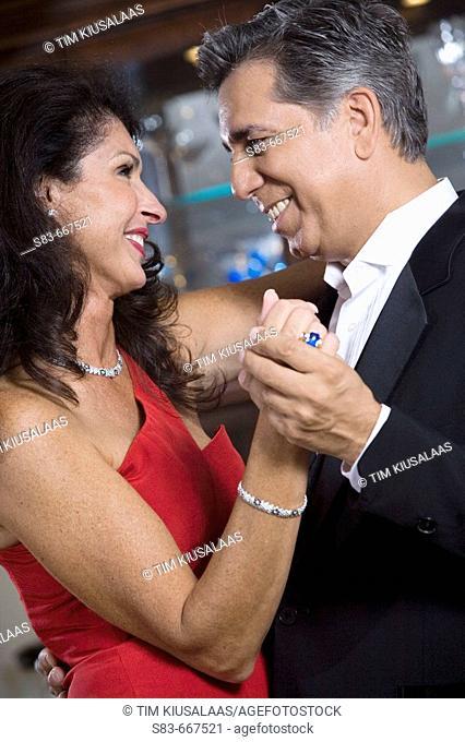 Couple dancing indoors