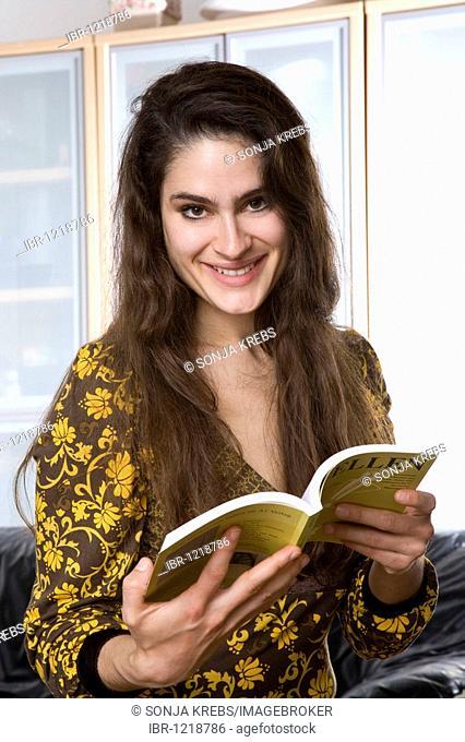 Girl holding opened book