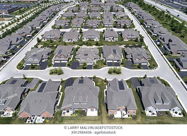 Aerial view of a townhouse complex in a semi-circular Chicago suburban neighborhood in summer. Northbrook, IL. USA