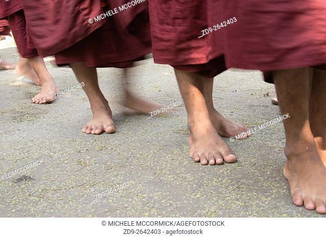 Monks line up for alms-collection