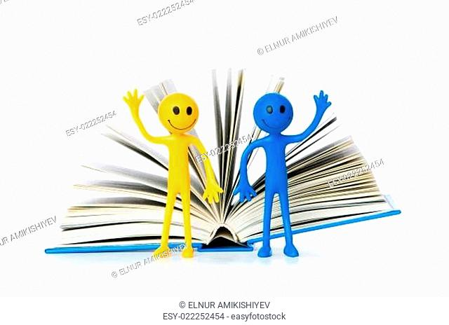 Education concept - books and smilie on white