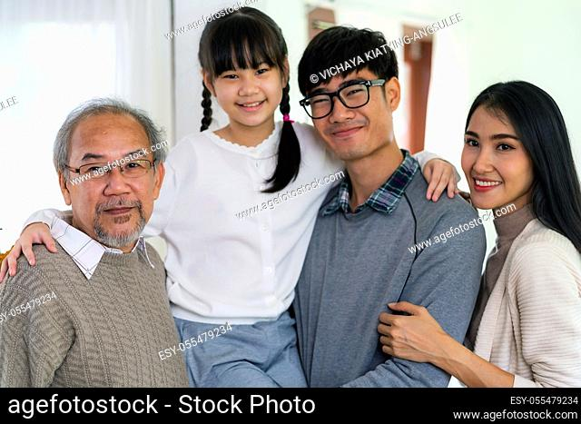 Group Portrait of Happy multigenerational asian family standing in living room with smile in new apartment. Muti genration family happiness concept