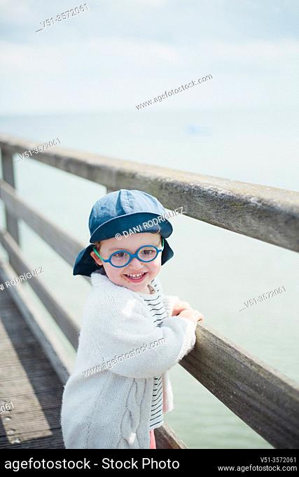 2 years old boy in a dock at the beach