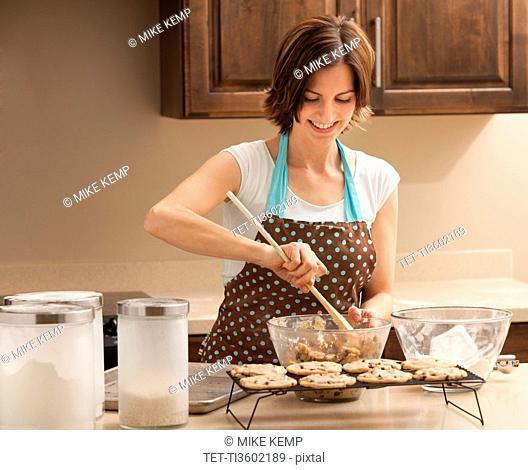 Woman preparing chocolate cookies