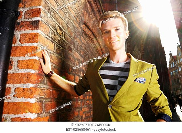 young handsome man fashion model casual style posing on street of old town gdansk poland europe