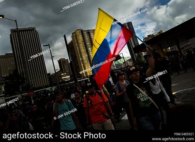 Students of the Universidad Nacional de Colombia, carrying the Colombian flag, take part in a protest march against government's policies and corruption within...