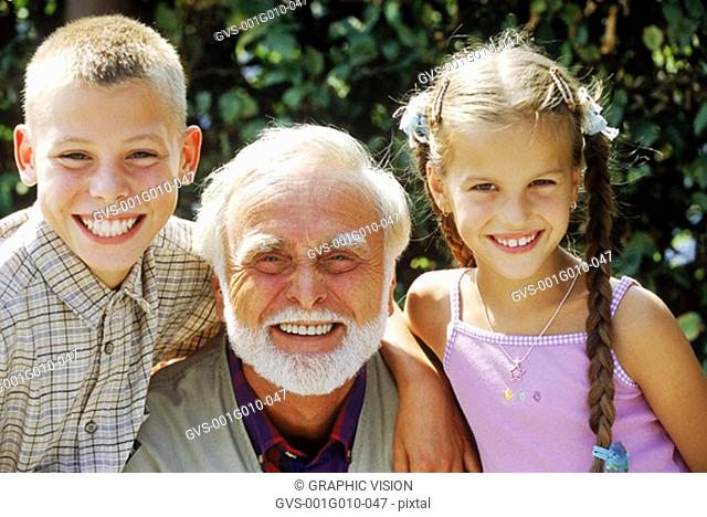 Close-up of a grandfather with grandchildren