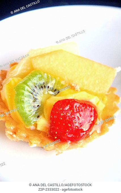 fruit cake with cream and puff caramel pastry