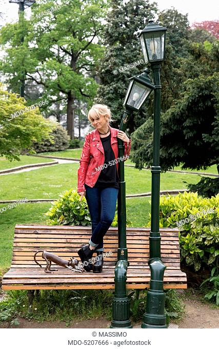 Actress and comedian Luciana Littizzetto standing on a bench inside the public park Parco del Valentino. Turin, Italy. 21st April 2016