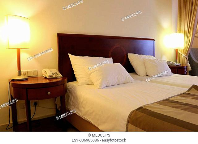 Hotel room equipped with queen size bed