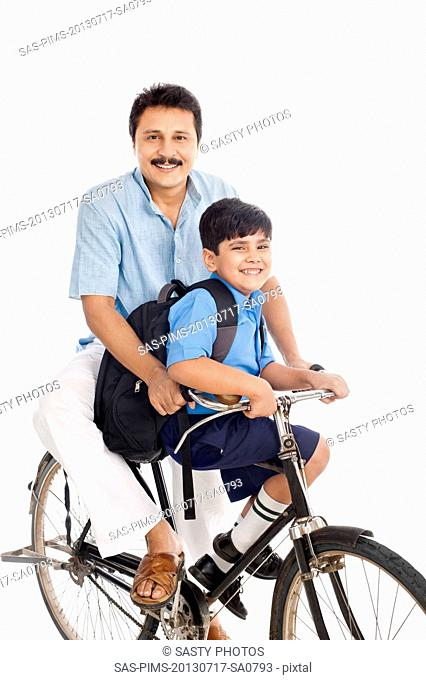Man with son on bicycle