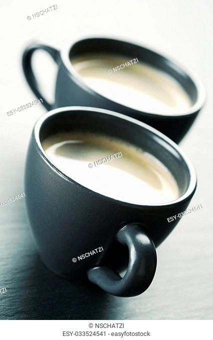 Two cups of coffee, toned