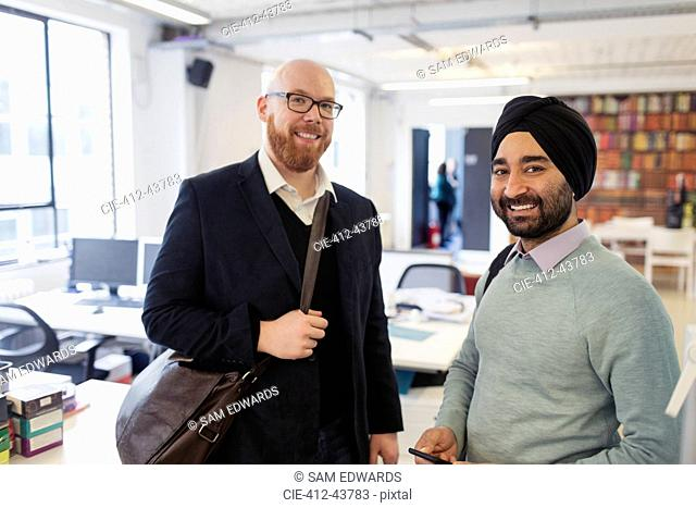Portrait smiling businessmen in office