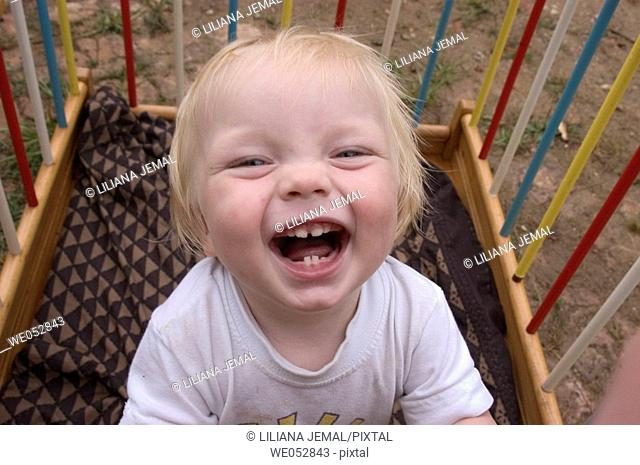 Boy laughing showing teeth