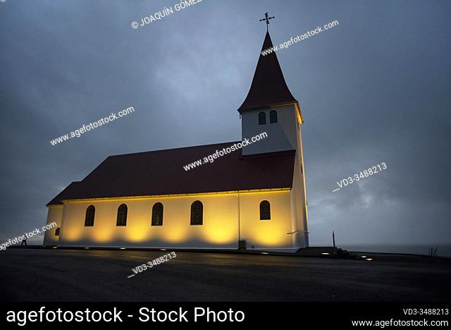 Sunrise view of the church of Vík (vikurkirkja), built in the 1930s, rises above the town of Vík in southern Iceland