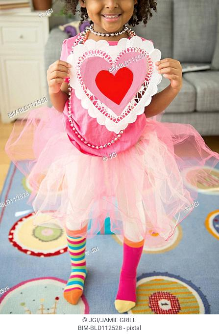 African American girl holding Valentine's Day card