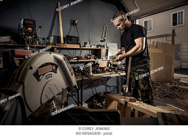 Male carpenter busy in workshop