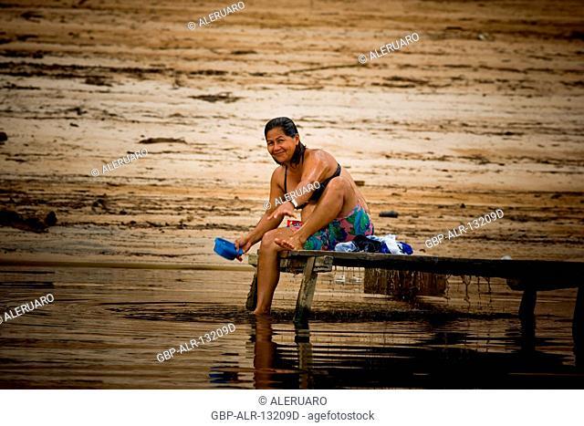 People Taking A shower in River, Terra Preta Community, Cuieiras River, Amazônia, Manaus, Amazonas, Brazil